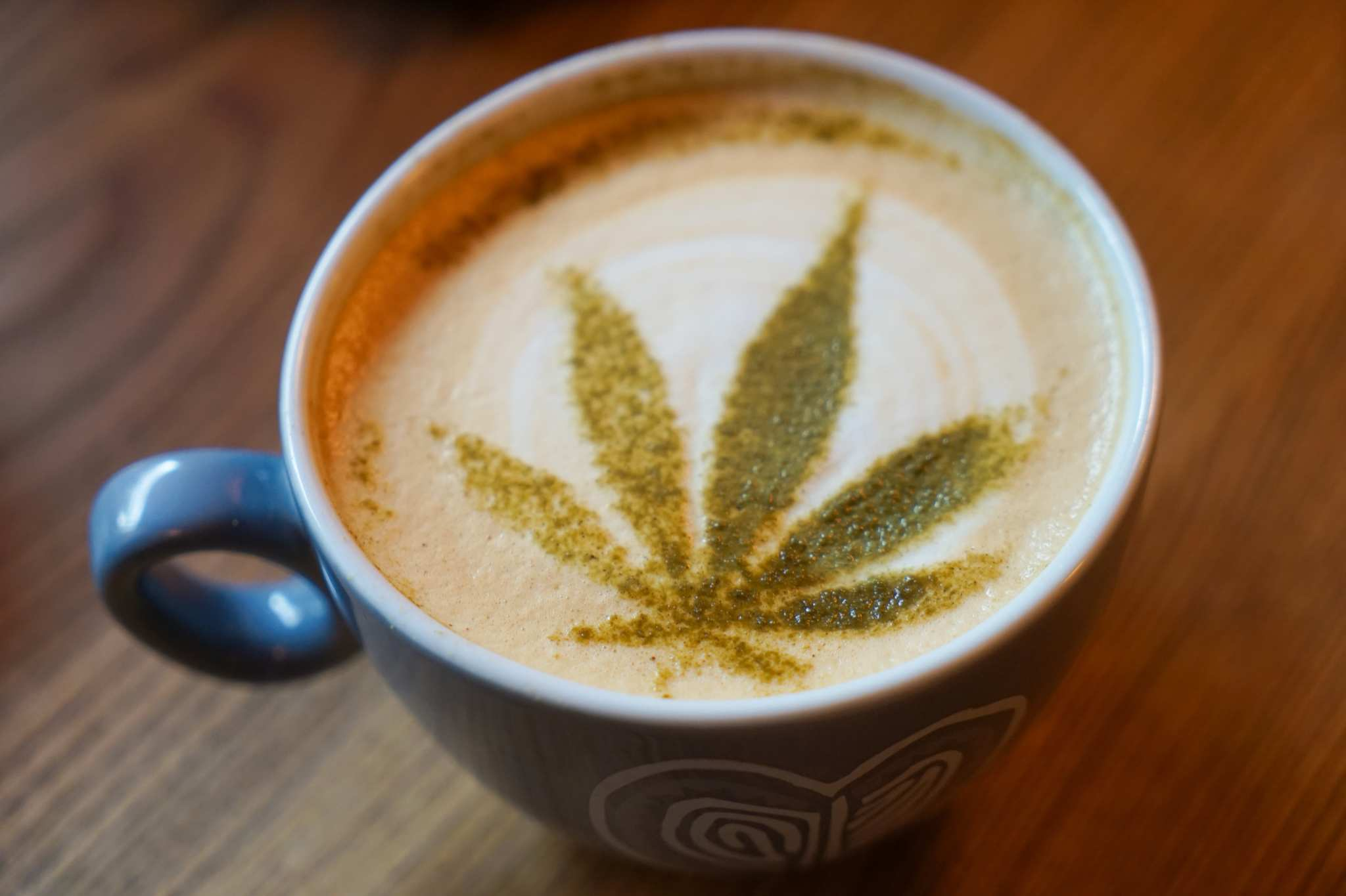 A coffee cup with a hemp leaf drawn in milk foam. Ready to get fancy with CBD coffee? Try this delicious, decadent peppermint CBD latte recipe.