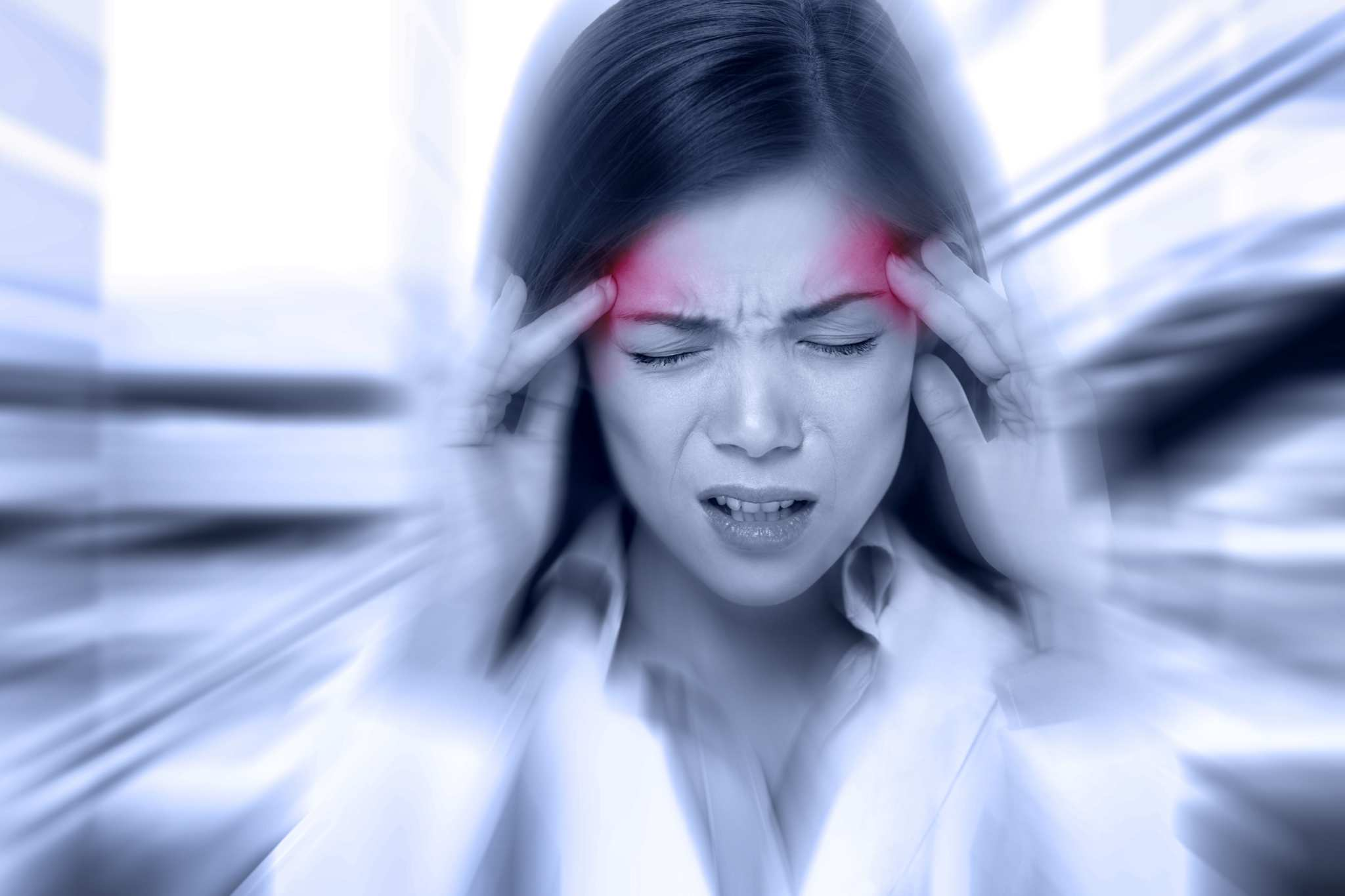 A woman clutches her head in pain, as if suffering from a migraine. Migraine sufferers have been shown to have lower levels of anandamide, a naturally occurring chemical found in all people that's similar to those found in cannabis and hemp.