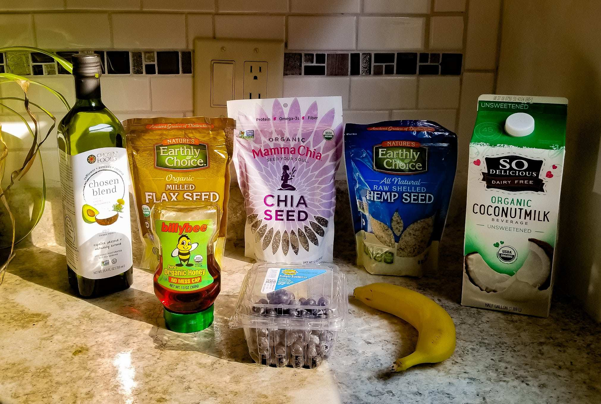 Smoothie ingredients on a counter, including hemp seeds. The keto diet focuses on low carbohydrate and high fat consumption, making hemp for keto a great option to ensure you get plenty of vital amino acids.