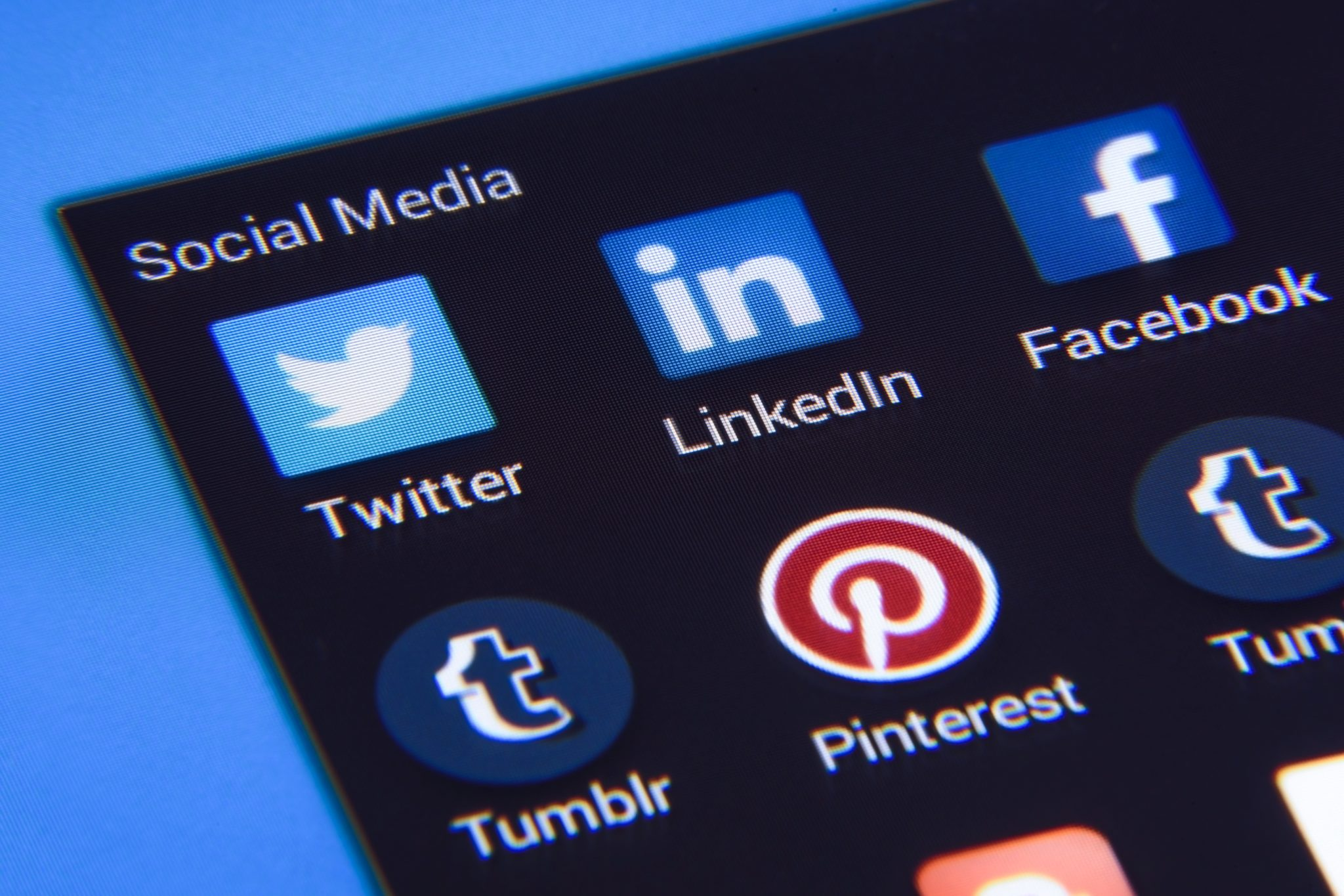 Graphic shows social media app icons on a smartphone screen, including Twitter, LinkedIn and Facebook. While shutting down CBD pages was an extreme move, Facebook and other social media services routinely block hemp and CBD brands from their advertising platforms.