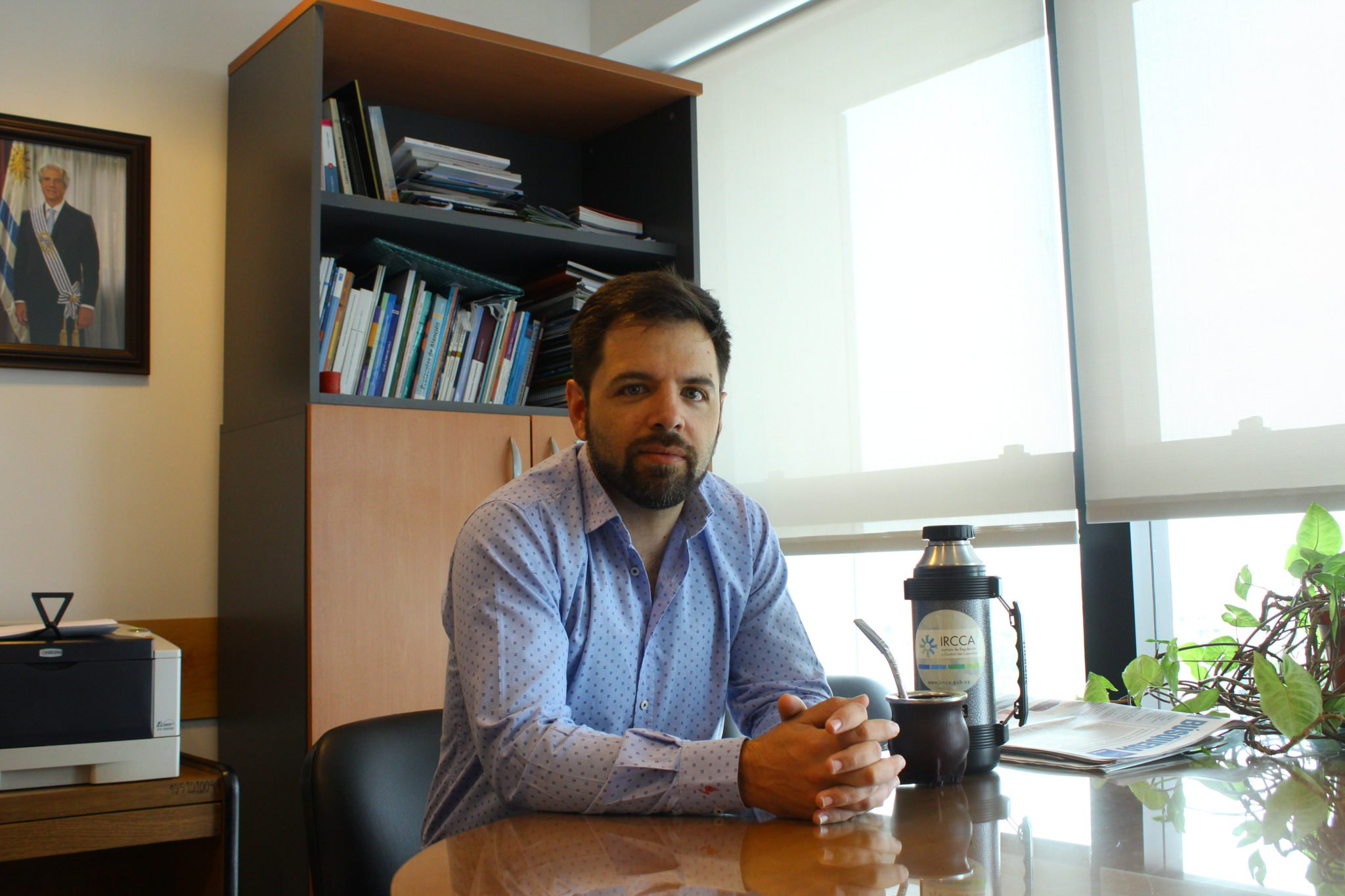 Diego Olivera, President of IRCCA, in his office with a thermos and mug of mate. IRCCA regulates cannabis in Uruguay, and Olivera anticipates a much greater diversity in hemp and cannabis products in 2019.