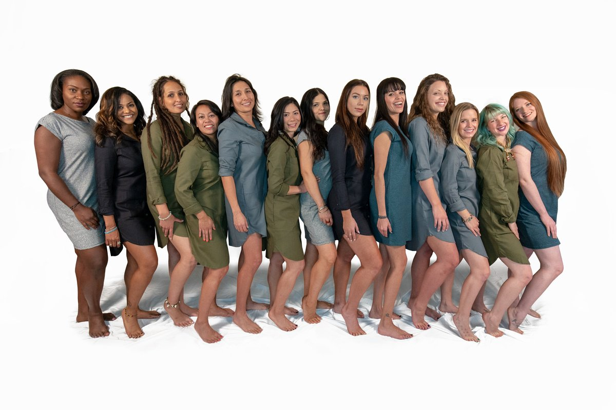 Cait Curley's Women Of Cannabis photos highlight the diversity of the people who support hemp and cannabis in all its forms. Photo: A row of diverse women pose standing back to front while wearing simple hemp dresses.