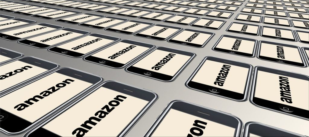 Photo: Image shows a rendering of an infinite number of tablet computers displaying the Amazon logo.