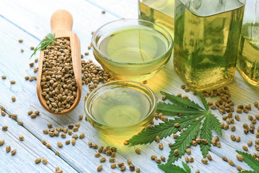 Hemp seeds and hemp seed oil offer many nutritional benefits, but they don't contain CBD oil. Photo: Hemp seeds and hemp seed oil arranged on a table.