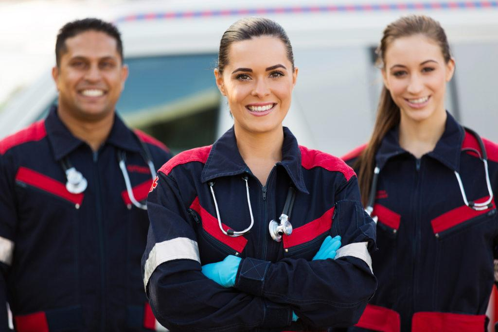 Because of the toll their work takes on their bodies, CBD is ideal for veterans, police, EMTs and other first responders. Photo: A trio of Emergency Medical Technicians in uniform smile, arms crossed.