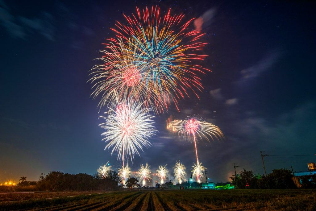 Despite the hemp boom, the reality for many hemp farmers is more difficult. Photo: Fireworks explode over a farm at night.