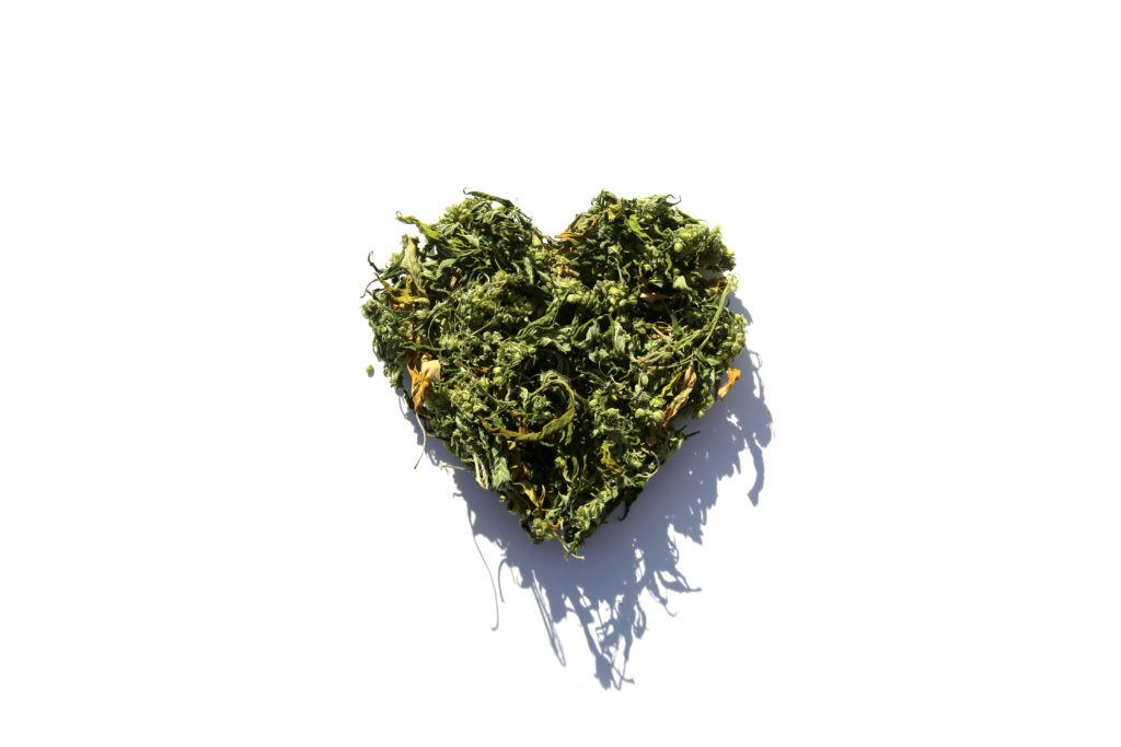 Ministry of Hemp picked the best CBD Valentine's Day gifts, along with a special CBD-infused recipe to enjoy. Photo: A Valentine's Day heart made from hemp buds and leaves woven together, against a white background.
