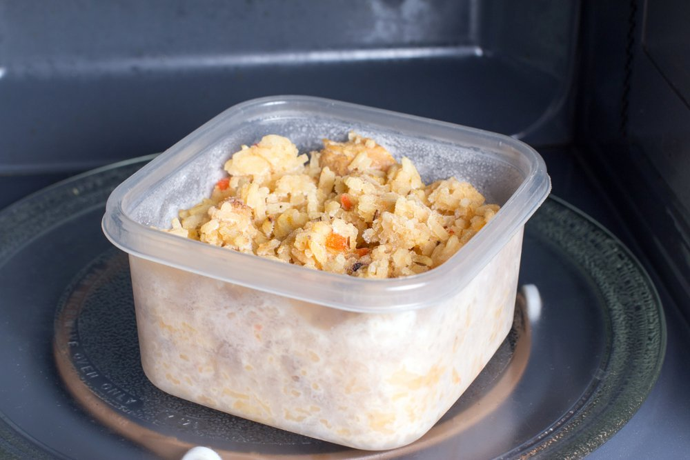 food in plastic container in microwave