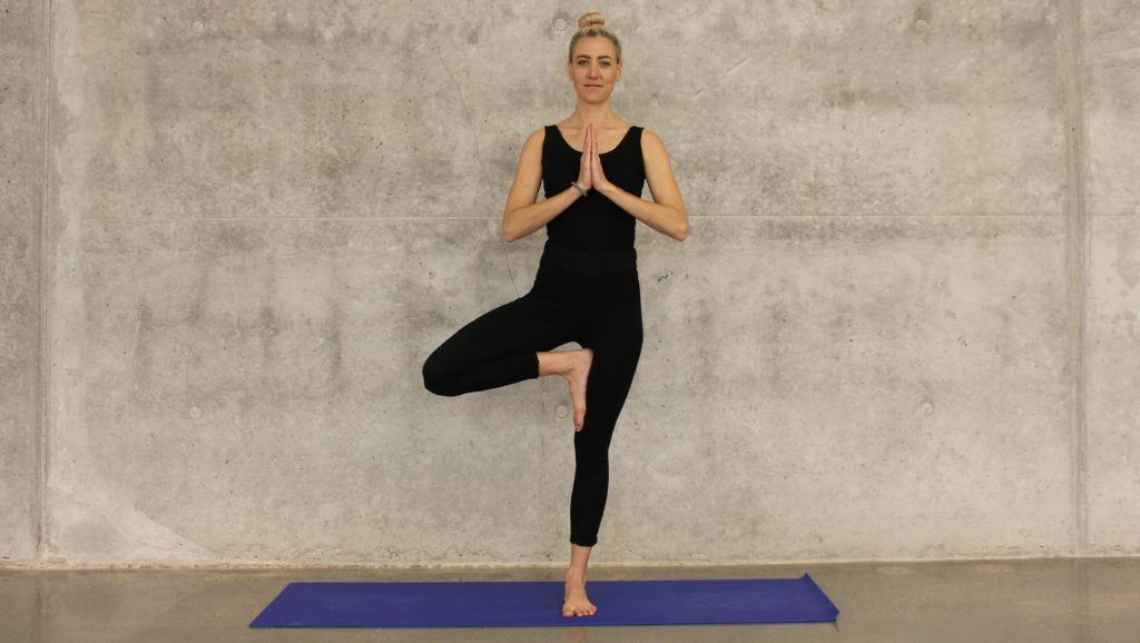 A woman does the yoga