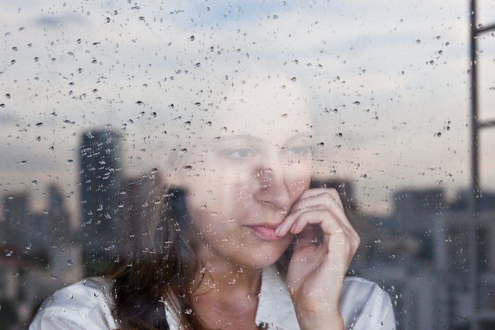 early-onset Alzheimer's | Melancholy reflection of the girl in the window