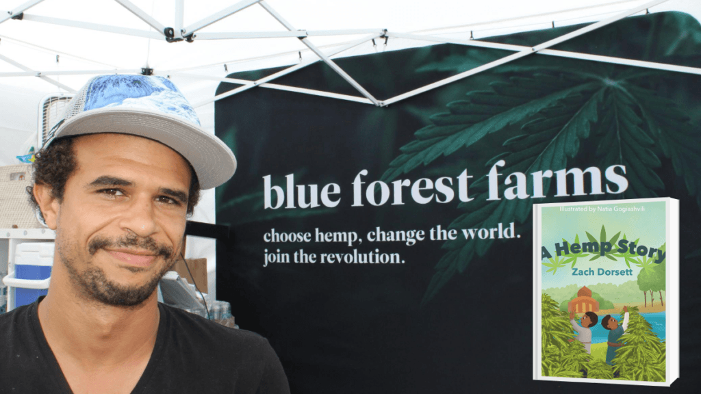 Photo: A photo of Zach Dorsett under a Blue Forest Farms awning. The motto reads