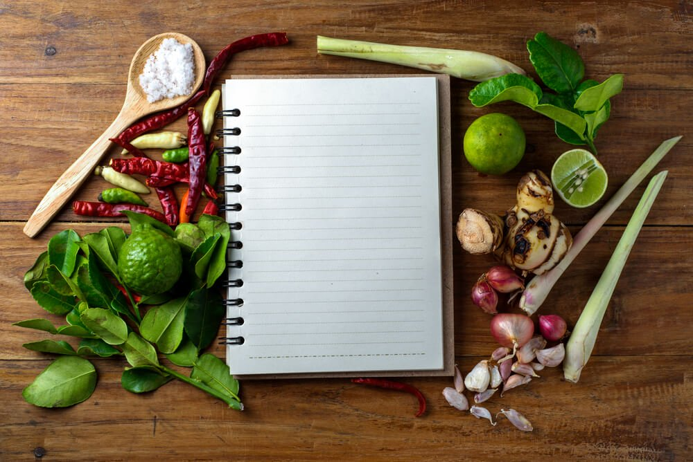 reach your goal weight   recipe book with fresh herbs south asia and spices on wooden background, thai food.