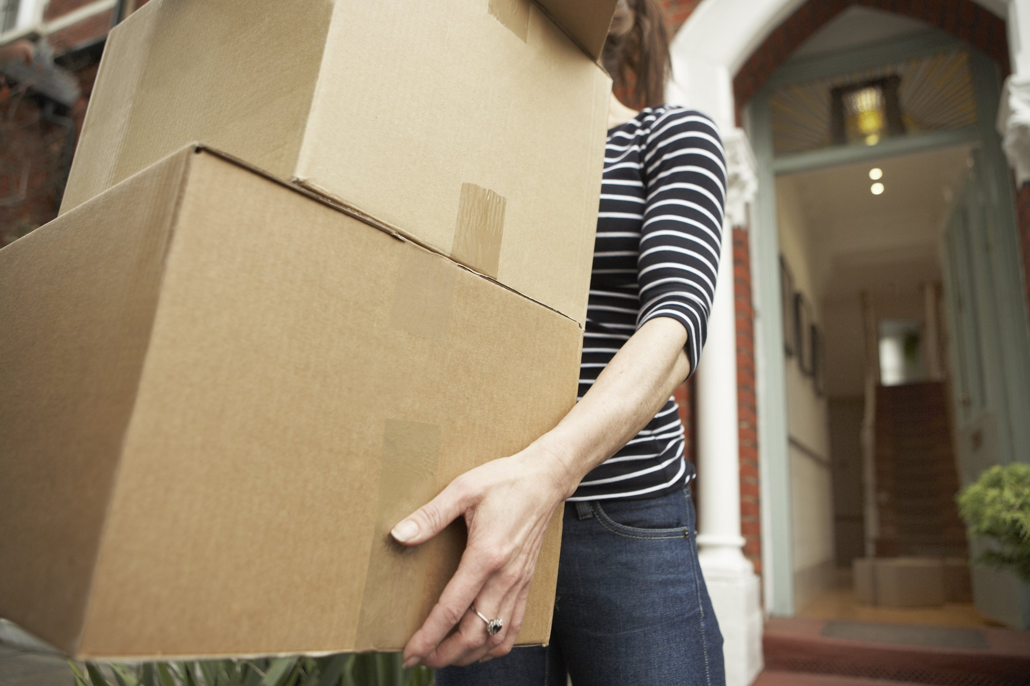 cause hemorrhoids | woman holding boxes