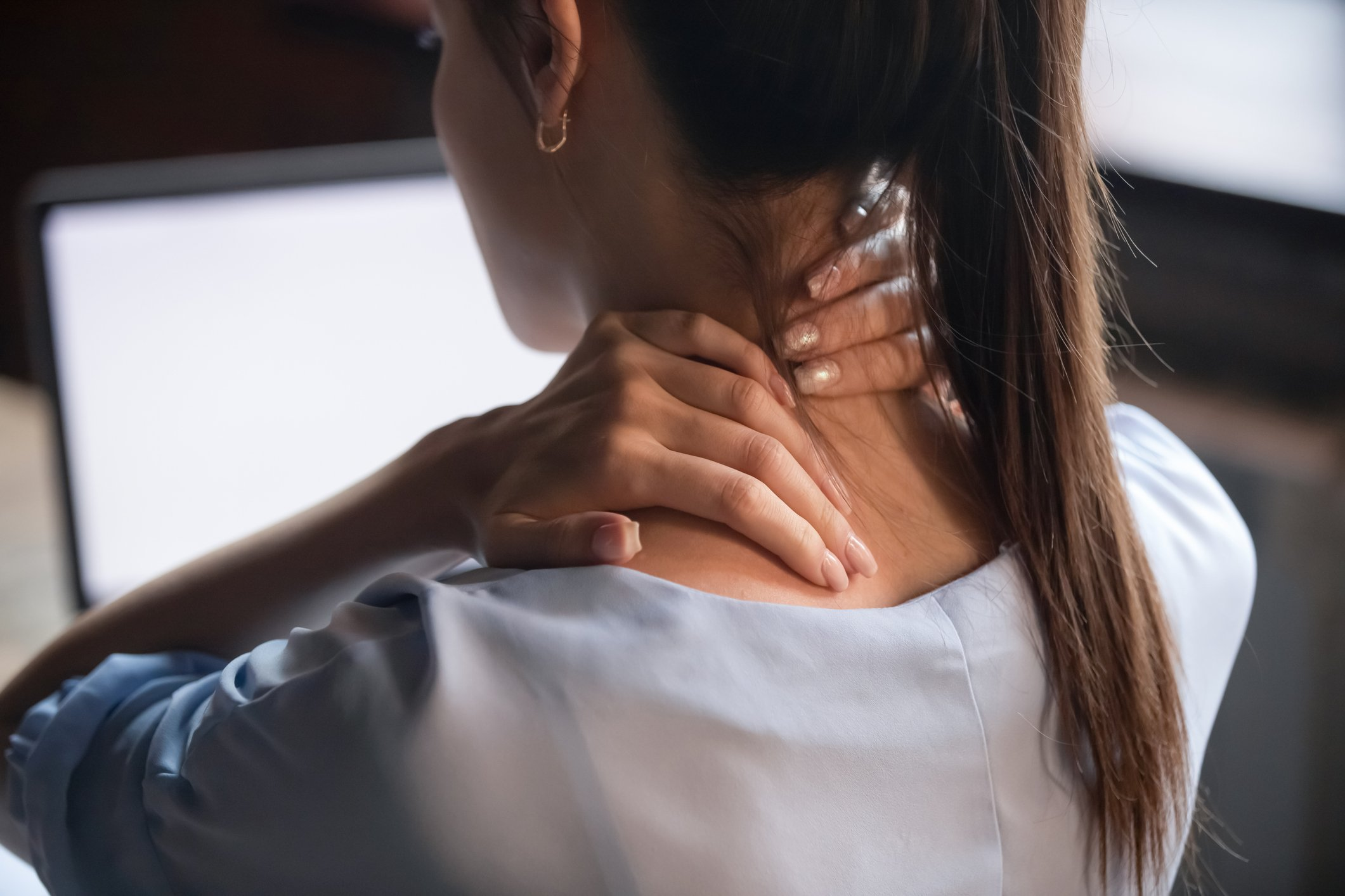 Fibromyalgia   rear view close up of woman with neck pain