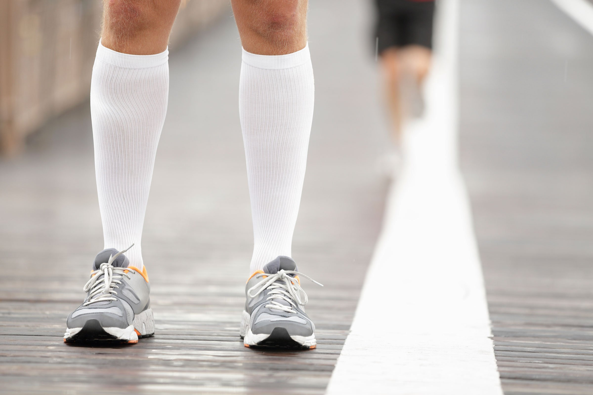 swollen feet | person wearing compression socks and sneakers