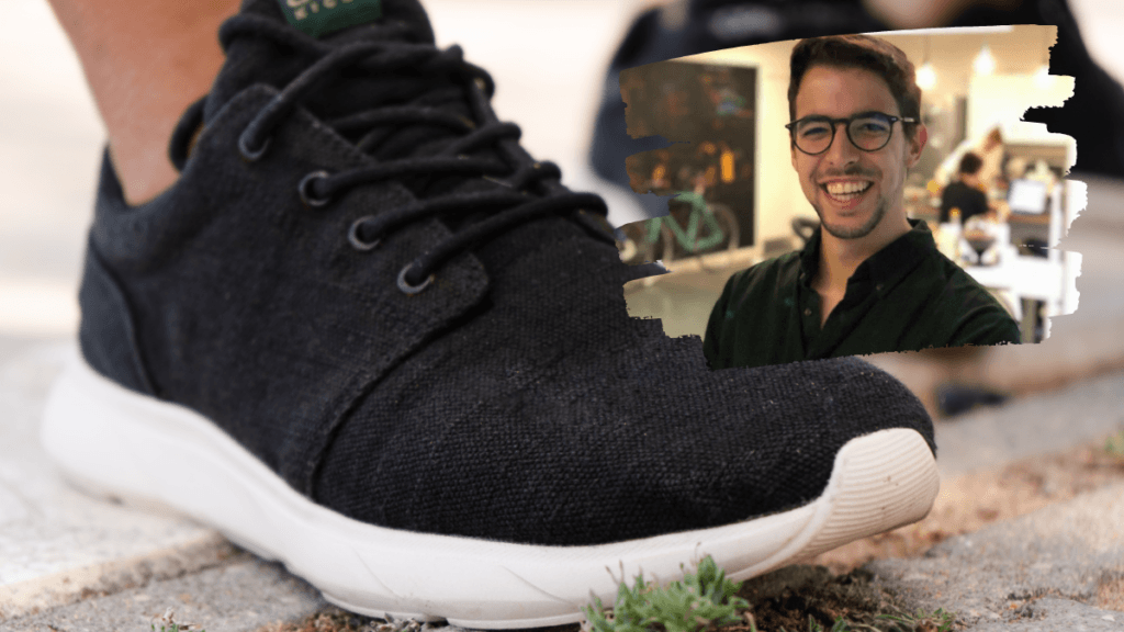 A pair of sneaker-style hemp shoes, with the body of the shoe dyed black and the base in white bioplastic rubber. in an insert photo is a headshot of the 8000 Kicks founder Bernardo Carreira.