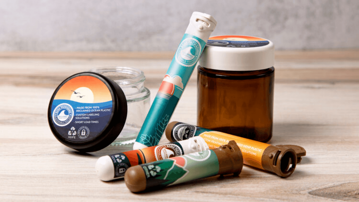 A collection of hemp plastic packagiing and packaging made from ocean plastic, designed for cannabis and hemp products, including jars and