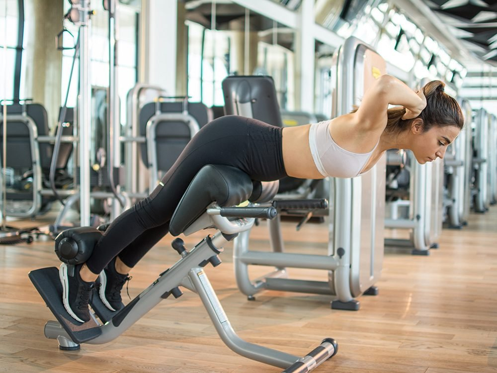 back extensions | Sports,young,woman,doing,exercises,on,trainer,back,machine,in